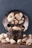 Pistachio nuts in metal cups Royalty Free Stock Photos