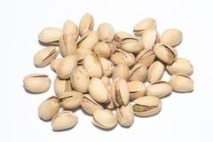 Pistachio Nuts Pile On White Background Stock Photos