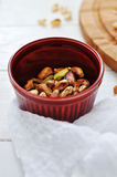 Pistachio nuts in red cup. Cracked pistachio nuts in red cup Royalty Free Stock Image