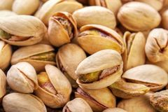 Pistachio nuts. Salted and roasted pistachio nuts background Stock Photography