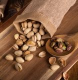 Pistachio Nuts Spilled From a Burlap Bag royalty free stock photo