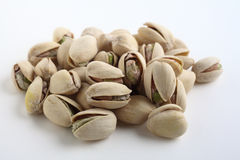 Pistachio nuts on white Royalty Free Stock Photos