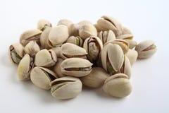 Pistachio nuts on white Royalty Free Stock Photos