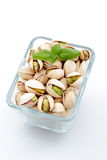 Pistachio nuts on white background Stock Photography