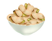 Pistachio nuts. In white bowl isolated Stock Photos