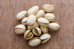 Pistachio nuts on wooden background texture Royalty Free Stock Images