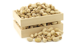 Pistachio nuts in a wooden box Royalty Free Stock Photography
