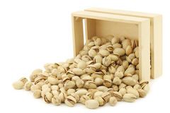 Pistachio nuts in a wooden box Stock Image