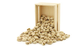 Pistachio nuts in a wooden box Stock Photography