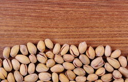 Pistachio nuts on wooden table, healthy eating Royalty Free Stock Photos