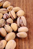 Pistachio nuts on wooden table, healthy eating Stock Image