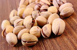Pistachio nuts on wooden table, healthy eating Royalty Free Stock Image