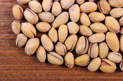 Pistachio nuts on wooden table, healthy eating Royalty Free Stock Photo