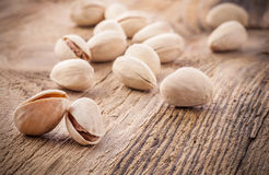Pistachio nuts on wooden table Stock Photography