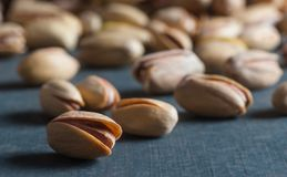 Pistachio in nutshell on black wooden rustic backdrop, composition of pistachios great for healthy and dietary nutrition. Concept of nuts stock image
