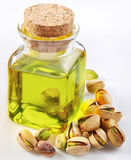 Pistachio oil with nuts Stock Photos