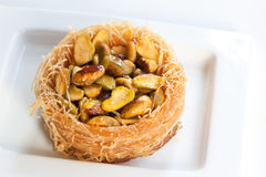 Pistachio Pastry. A pistachio- filled pastry on a white plate Royalty Free Stock Images