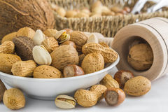 Pistachio, peanuts, almonds, hazelnuts, walnuts, brazil nuts, co Stock Photos