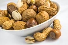 Pistachio, peanuts, almonds, hazelnuts, walnuts, on small bowl Royalty Free Stock Image