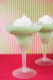 Pistachio Pudding. Topped with whipped cream and served in frosted margarita glasses Stock Image