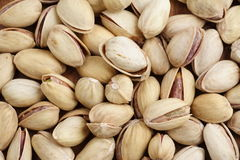 Pistachio's. Background of roasted pistachio-nuts Stock Photos
