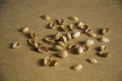 Pistachio. Scattered pistachios, shelled and peeled Royalty Free Stock Photo