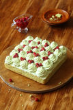 Pistachio Sponge Cake with Wild Strawberry Filling and Pistachio Frosting Stock Photo