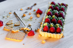 Pistachio tart. Pistachio tart on white Belgian chocolate BARRY with a layer of raspberry confit, crispy shortbread base. Fading cream and juicy raspberries.A Royalty Free Stock Photos