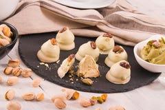 Pistachio truffles. Pistachio truffles with crema filling on black dish royalty free stock image
