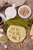 Pistachio truffles. Pistachio truffles with cream filling on white dish royalty free stock image