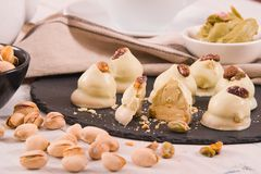 Pistachio truffles. Pistachio truffles with cream on wooden table royalty free stock photos