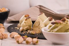 Pistachio truffles. Pistachio truffles on wooden table royalty free stock photo