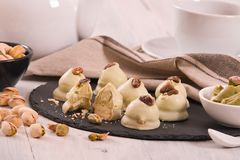 Pistachio truffles. Pistachio truffles on wooden table stock photo