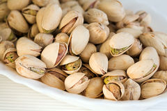Pistachios. Detail of pistachios on white background Royalty Free Stock Image