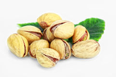 Pistachios. With leaf on a white background Royalty Free Stock Photo