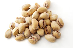 Pistachios. On the white background Royalty Free Stock Photos