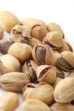 Pistachios. On the white background Royalty Free Stock Photo