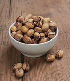 Pistachios. On old wooden table Royalty Free Stock Images