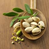 Pistachios. Fresh pistachios on wooden ground Stock Images