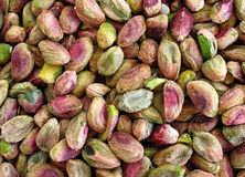 Pistachios. A background of unsalted green pistachio nuts Royalty Free Stock Images