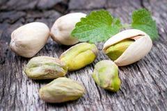 Pistachios. Fresh pistachios on wooden ground royalty free stock image
