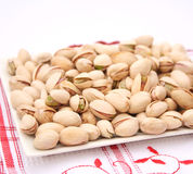 Pistachios. Some fresh roasted pistachios on a plate royalty free stock photos