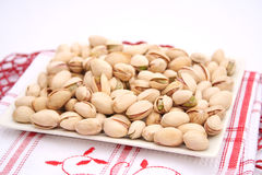Pistachios. Some fresh roasted pistachios on a plate stock photos