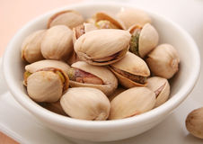 Pistachios. Some fresh roasted pistachios in a bowl royalty free stock photography