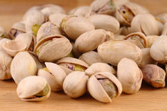Pistachios. Baked pistachios on a wooden background Stock Image
