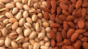 Pistachios and almonds close up, view from the above, food background, panning effect. Close up video of roasted pistachio nuts and almonds, top view stock footage