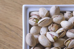 Pistachios bowl. Delicious appetizer of roasted pistachios Royalty Free Stock Image