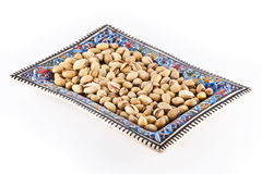 Pistachios in bowl Stock Image