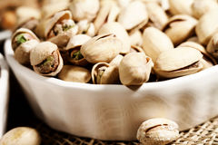 Pistachios in a bowl background Royalty Free Stock Images