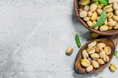Pistachios in the bowl stock image